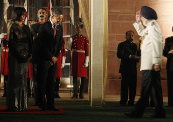 U.S. President Barack Obama and first lady Michelle Obama are greeted by the Marshal of India's Air Force Arjan Singh in New Delhi