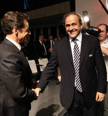 UEFA President Platini shakes hands with France's President Sarkozy after France was chosen to host Euro 2016, in Geneva