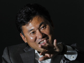 Rakuten Inc Chairman and President Hiroshi Mikitani speaks during an interview in Tokyo