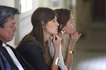 Geraldine Pillet, friend of Nikola Karabatic, and Jeny Priez, friend of Montpellier's handball player Luka Karabatic, sit outside the courtroom at the Montpellier's courthouse