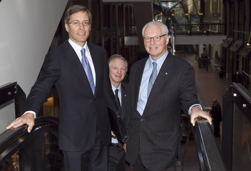 President and CEO of Power Financial Corporation Orr stands on an escalator with Co-Chairmen Desmarais Jr. and his brother Andre prior to the company's annual general meeting in Montreal
