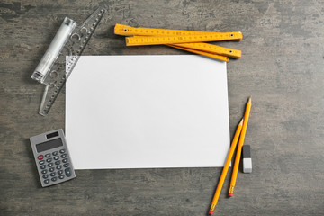 White paper and engineer supplies on table
