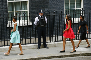 The daughters of U.S. first lady Michelle Obama arrive at Number 10 Downing Street in London