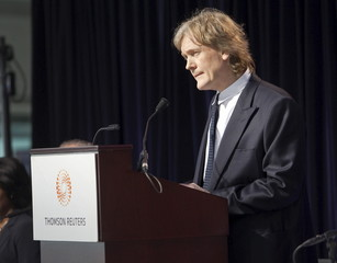 Chairman of Thomson Reuters David Thomson listens to questions from shareholders in Toronto