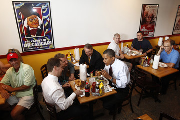 Russian President Dmitry Medvedev and U.S. President Barack Obama talk over lunch at Ray's Hell Burger in Arlington, Virginia