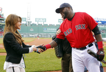 Entertainer Paula Abdul greets Boston Red Sox's David Ortiz before the MLB Interleague baseball game between the Nationals and the Red Sox at Fenway Park in Boston