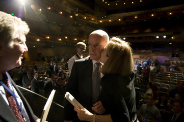 Democratic candidate Jerry Brown is kissed by his wife Anne Gust after the first of three debates in the California governor's race at the University of California, Davis