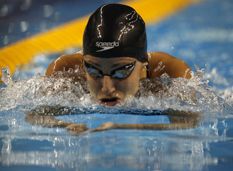 Lebanon's Katya Bachrouche competes in the women's 200m individual medley final at the Arab Games in Doha