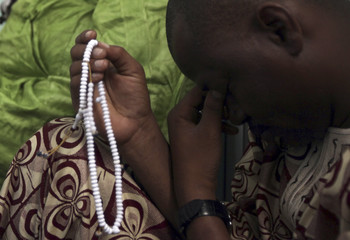 A worshipper holds prayer beads during  Friday prayers at the only mosque in the Bisa area of Bata, which will host tomorrow's opening ceremony for the African Nations Cup