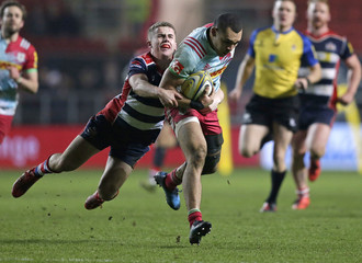 Joe Marchant of Harlequins tackled by Billy Searle of Bristol Rugby
