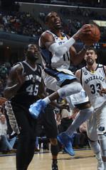 Memphis Grizzlies' Conley elevates to shoot between San Antonio Spurs' Blair and Memphis Grizzlies' Gasol during NBA basketball action in Memphis