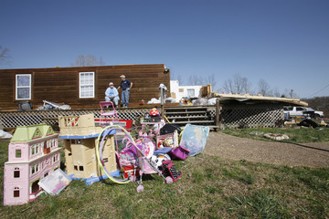 Tim Vickers and his wife Ellen sit on the porch of what remains of their son's home near Crossville, Tennessee