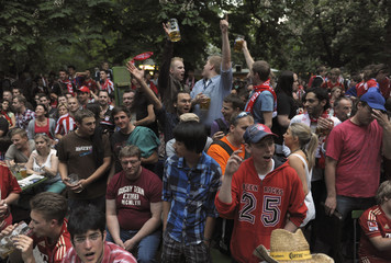 Bayern Munich supporters watch the Champions League final soccer match against Chelsea at a beergarden in Munich