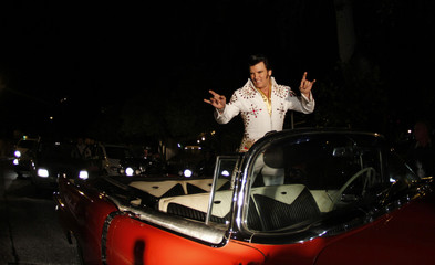 "Elvis Presley impersonator Miller poses in a Cadillac during a presentation of  ""The King Story"" in Palma de Mallorca"