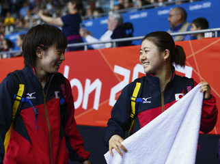 Japan's Kasumi Ishikawa and Ai Fukuhara leave after their women's team first round table tennis match against the U.S. at the ExCel venue during the London 2012 Olympic Games