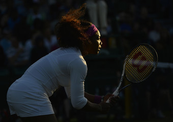 Serena Williams of the U.S. stands ready during her women's doubles tennis match with her partner Venus Williams of the U.S. against Maria Kirilenko of Russia and Nadia Petrova of Russia at the Wimbledon tennis championships in London
