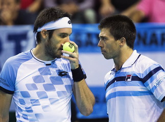 Argentina's Leonardo Mayer and Carlos Berlocq react during their Davis Cup semi-final double match against Belgium's Steve Darcis and Ruben Bemelmans in Brussels