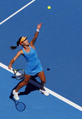 Ana Ivanovic of Serbia serves to Kiki Bertens of the Netherlands during their women's singles match at the Australian Open 2014 tennis tournament in Melbourne