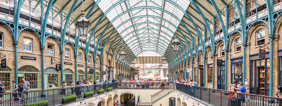LONDON - JUNE 2013: People in Covent Garden. London is visited by 30 million people annually
