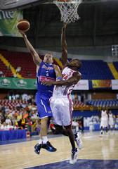 Barea of Puerto Rico jumps to score against Pineiro of Cuba during the men's FIBA Americas 2010 Centrobasket Championship game in Santo Domingo