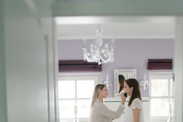 Bridal getting ready in bathroom
