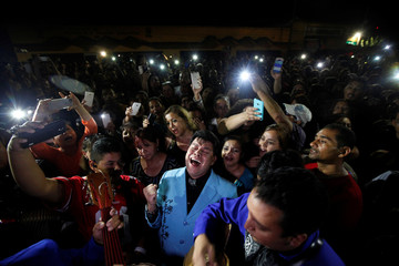 Fans perform songs from iconic Mexican singer and song writer Juan Gabriel outside his house after his death, in Ciudad Juarez