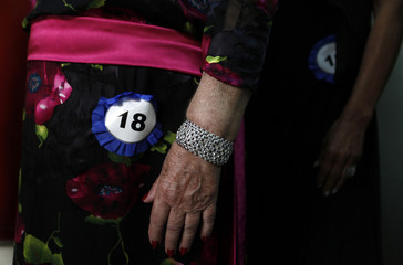 Competitors of Sao Paulo's Elderly Beauty women contest line up before they parade in Sao Paulo