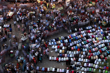 Protesters pray during a protest at Tahrir square in Cairo