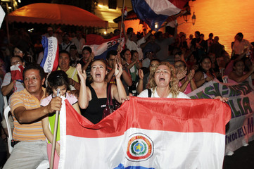 Paraguayans celebrate after Brazil's Senate voted in favor of a law which triples the amount that Brazil will pay Paraguay for energy from Itaipu in Asuncion