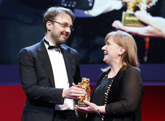 "Director Netzer and producer Solomon hold the Golden Bear award for Best Film for their movie ""Pozitia Copilului"" (Child's Pose) during the awards ceremony at the 63rd Berlinale International Film Festival in Berlin"