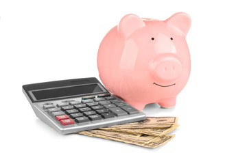 Piggy bank, banknotes and calculator on white background