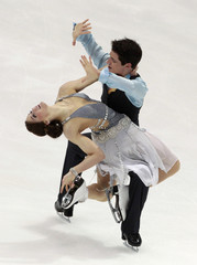 Virtue and Moir of Canada perform during the ice dance short dance program competition at the ISU Four Continents Figure Skating Championships in Taipei