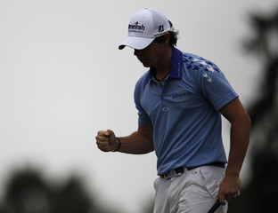 McIlroy reacts after his par on the fifth green during the final round of the 2011 U.S. Open in Maryland