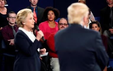 Ken Bone listens to Democratic presidential nominee Clinton along with Republican nominee Trump during their presidential debate in St. Louis