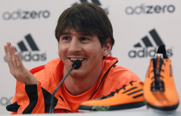 Barcelona's soccer player Lionel Messi of Argentina speaks as he presents his Adidas adiZero F50 shoes during a news conference in Barcelona