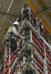 Construction worker erects framing on concrete towers for the new Silver Spring Library in Maryland