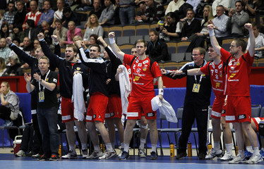 Iceland players celebrate after defeating Norway in their Group B match at Men's Handball World Championship in Linkoping