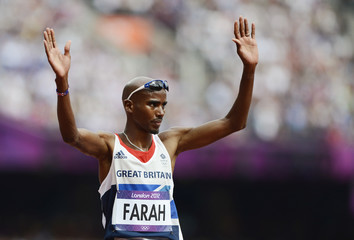 Britain's Mo Farah acknowledges the applause after taking third place in his men's 5000m round 1 heat at the London 2012 Olympic Games at the Olympic Stadium