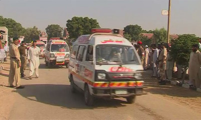 Still image from video shows ambulances at the site where a small charter plane crashed in Karachi