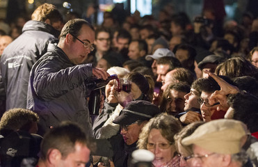 People attend the official launch of the 2012 Beaujolais Nouveau wine in the center of Lyon