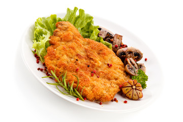 Fried pork chop with mushrooms on white background