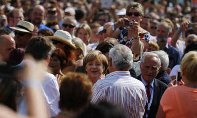 German Chancellor and top candidate of the Christian Democratic Union (CDU) Merkel arrives for an election campaign of Bavarian sister party Christian Social Union (CSU) in the Bavarian town of Aschaffenburg