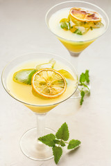 Cocktail of citrus in glasses on a white background.