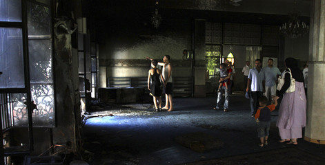 Residents walk inside a mosque damaged during clashes at Burj Abi Haidar street in Beirut