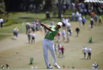 Canada's Mike Weir hits a shot on the first hole during the third round of the Masters golf tournament at the Augusta National Golf Club in Augusta