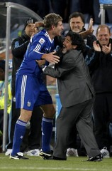 Argentina's coach Maradona celebrates with Palermo during a 2010 World Cup Group B soccer match against Greece in Polokwane