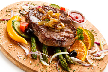 Grilled beefsteak with asparagus on cutting board