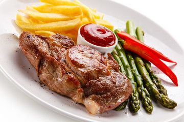 Grilled steak with french fries and asparagus on white background