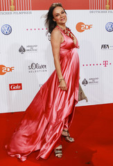 German actress Kirchberger poses on the red carpet as she arrives for the German Film Prize (Lola) ceremony in Berlin