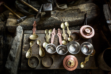 Traditional Tibetan copper handicraft products in a workshop in Chilling village in the Indian Himalaya. Chilling, Ladakh, India